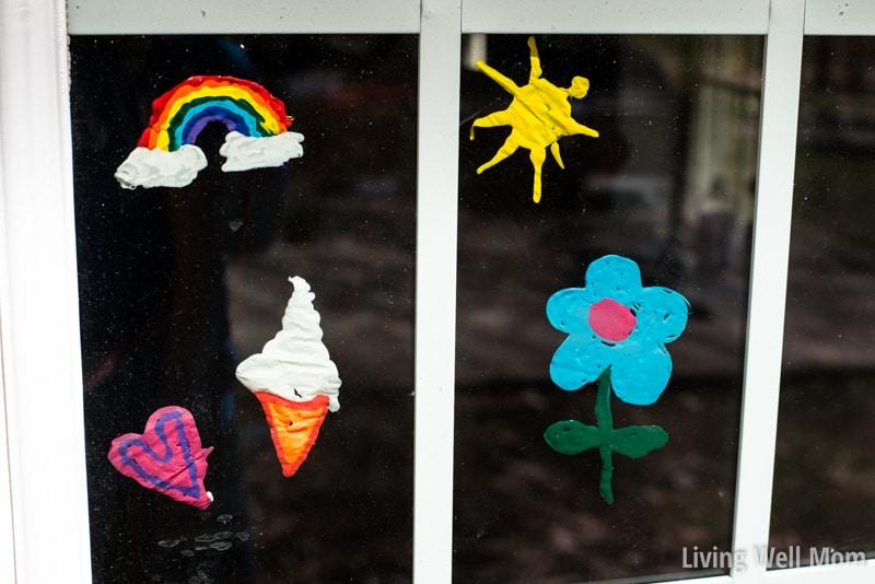 homemade colorful window clings with rainbow, sun, flower, ice cream designs