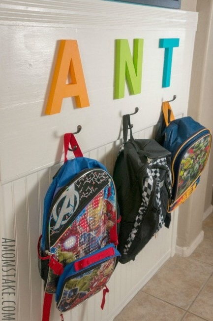 DIY Backpack Station with hanging backpacks