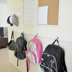 A simple and budget-friendly way to keep backpacks organized.