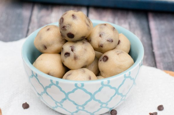 Looking for a healthier satisfying treat? This Paleo Cookie Dough Bites recipe is your winner! This sweet treat is easy, takes less than 5 minutes to whip up and is SO tasty! It's dairy-free, egg-free, and refined sugar free too. Yum!