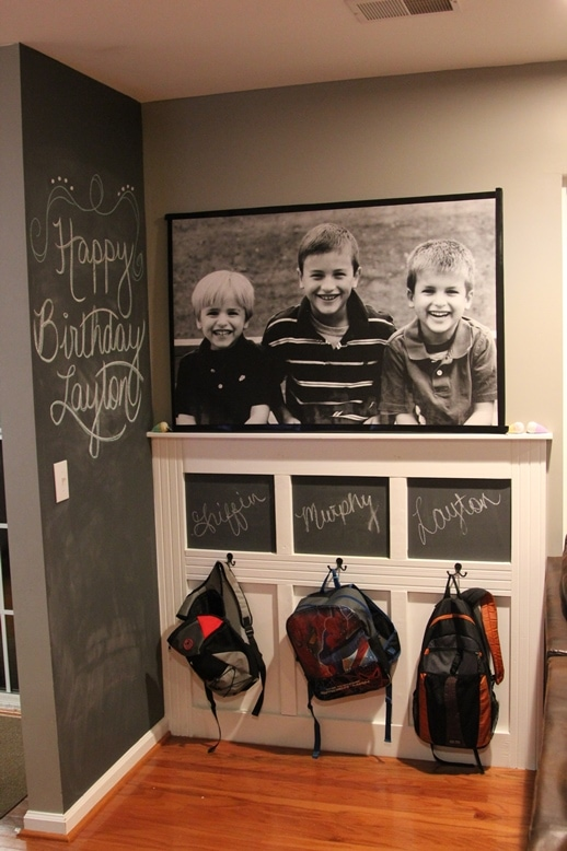 The Backpack Wall with chalk paint walls and hooks for backpacks