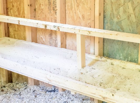 """Save time and effort with this simple dropping board concept for your chicken coop. Find out how to build it and the """"secret"""" that makes it work so well!"""