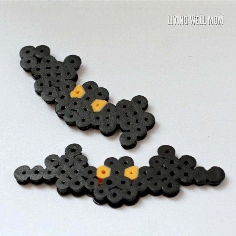 Halloween Melting Bead Art is a fun activity to do with kids. Here's the step by step simple pattern for making a fun jack-o-lantern and Halloween bat.
