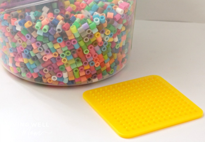 perler beads and a yellow board