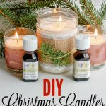 DIY candles made in mason jars next to essential oils
