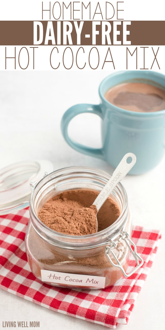 hot cocoa mix powder in a jar with a spoon and mug