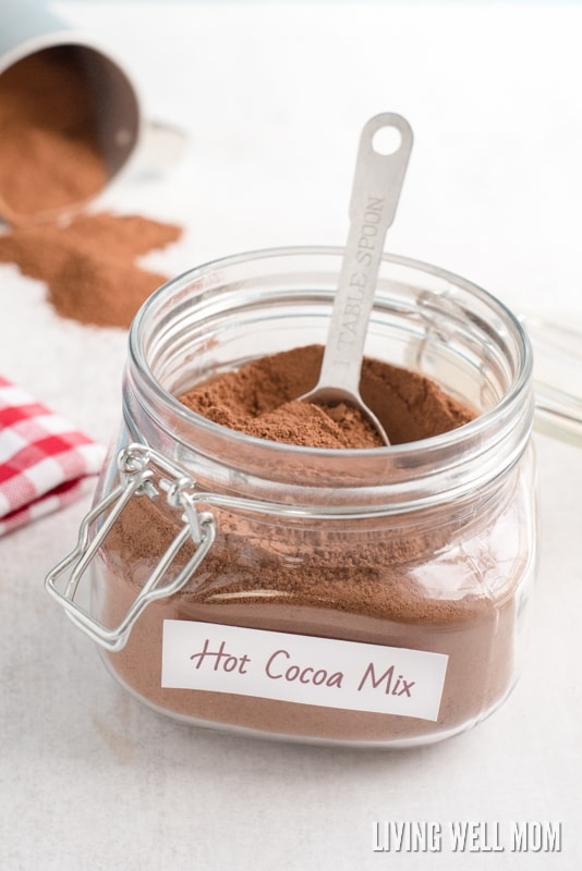 homemade hot cocoa mix powder in a glass mason jar with a tablespoon