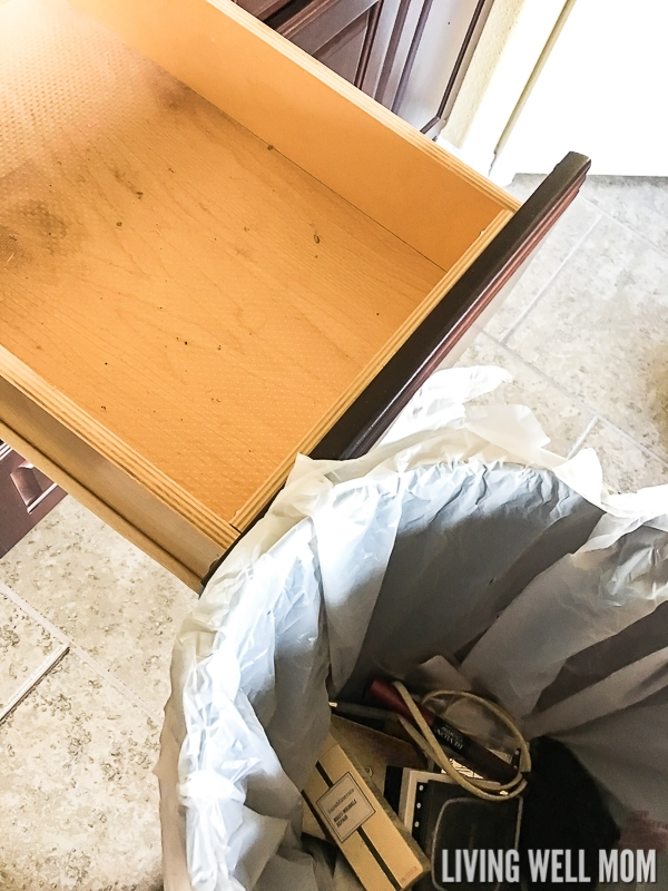 empty drawer with trash can