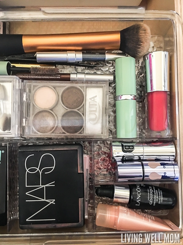 Overhead shot of makeup in a clear drawer organizer