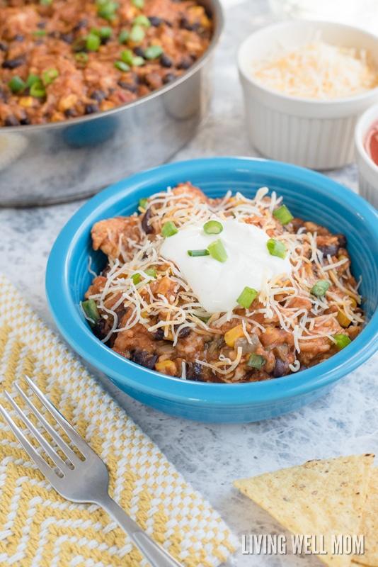 A bowl of enchilada casserole with turkey.