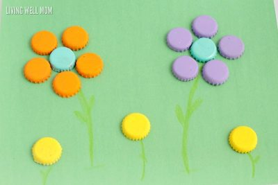 Make an adorable bottle cap garden when you make these painted bottle cap flowers! Kids will love this simple and fun craft.