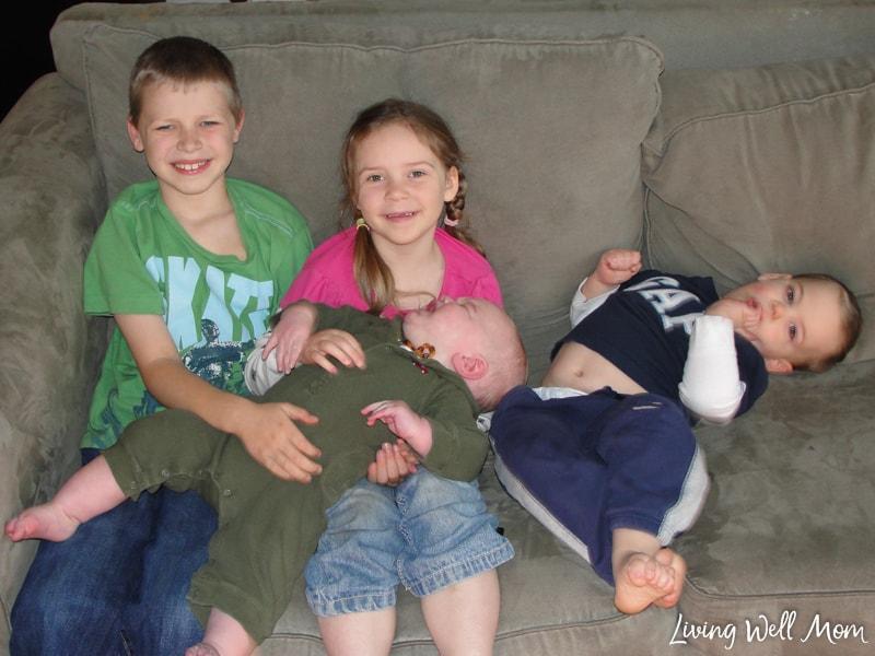 four children sitting on a coach
