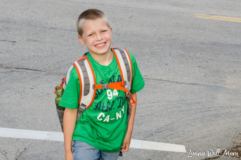 A little boy that is standing in a parking lot