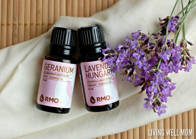 lavender and geranium essential oils next to flowers