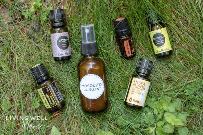 homemade mosquito repellent with essential oils in grass