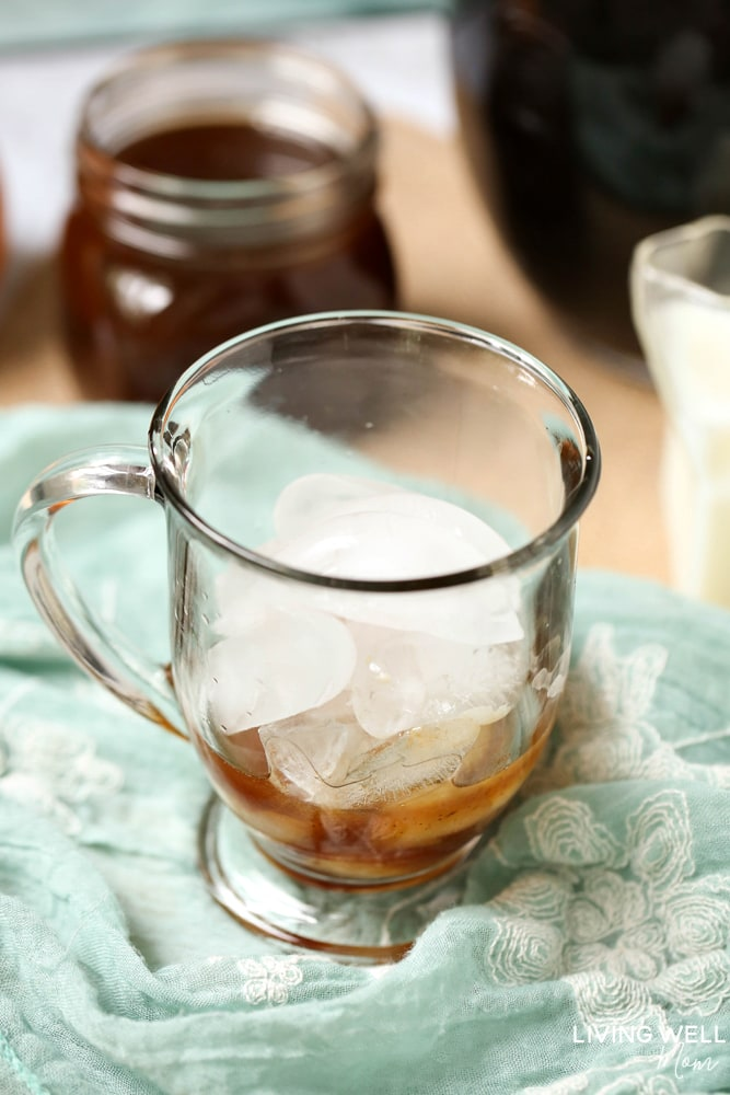 If you like pumpkin spice, you'll love this easy homemade pumpkin spice iced coffee recipe with a fabulous homemade pumpkin spice syrup! It's simple to make and you can save the syrup to use again and again for your favorite fall beverage.
