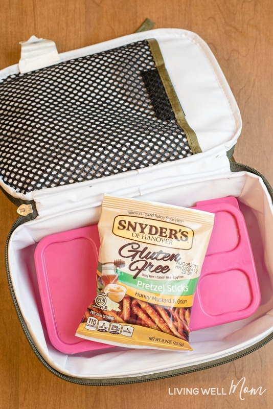 Are you tired of packing school lunches every day? Here are 6 ways to make packing lunches easier...for you and the kids! Plus tips on how to motivate your kids to do it themselves, along with a simple DIY school lunch menu and snack bin idea!