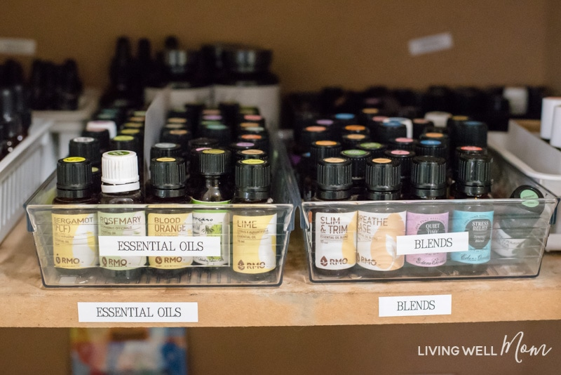 essential oil bottles in a clear plastic container