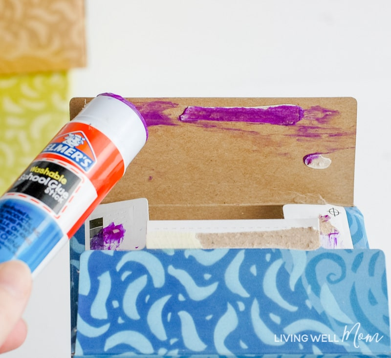 glue stick gluing open tissue box back together