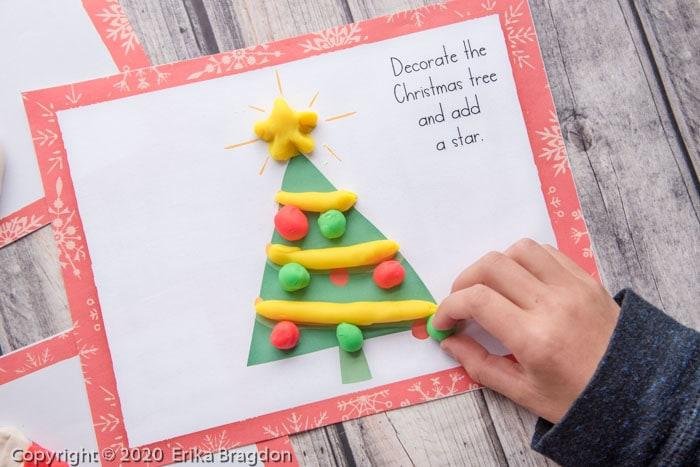 decorating a playdough christmas tree