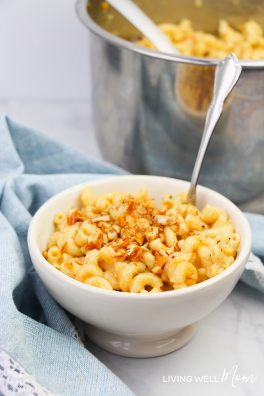 Homemade macaroni and cheese in a bowl with a spoon.