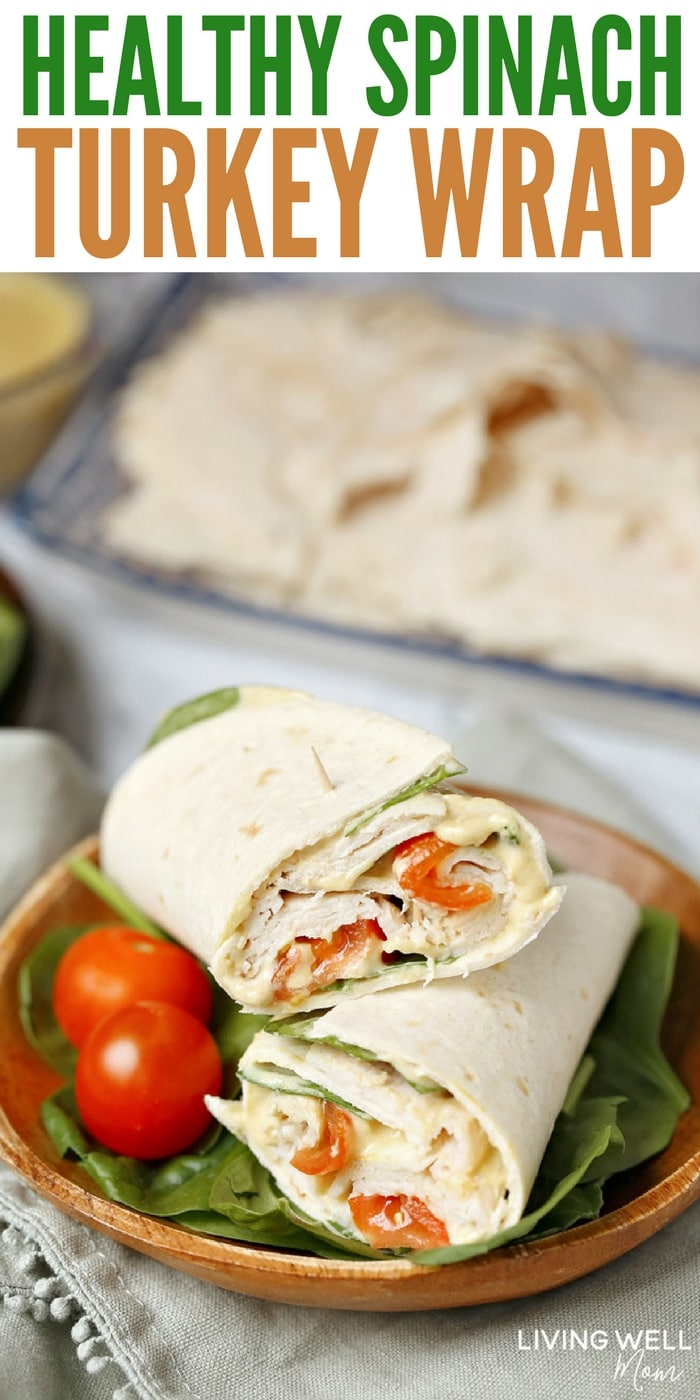 With delicious maple honey turkey slices, spinach, tomatoes, hummus, mayo, and Dijon mustard layered in a wrap, this Healthy Spinach Turkey Wrap is as satisfying and filling as it is tasty. It's a delicious, good-for-you alternative to the boring sandwiches or other common lunches we often eat. #healthyrecipes #lunch #easyrecipe
