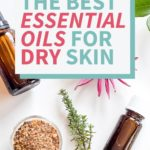 essential oil bottles and flowers for dry skin