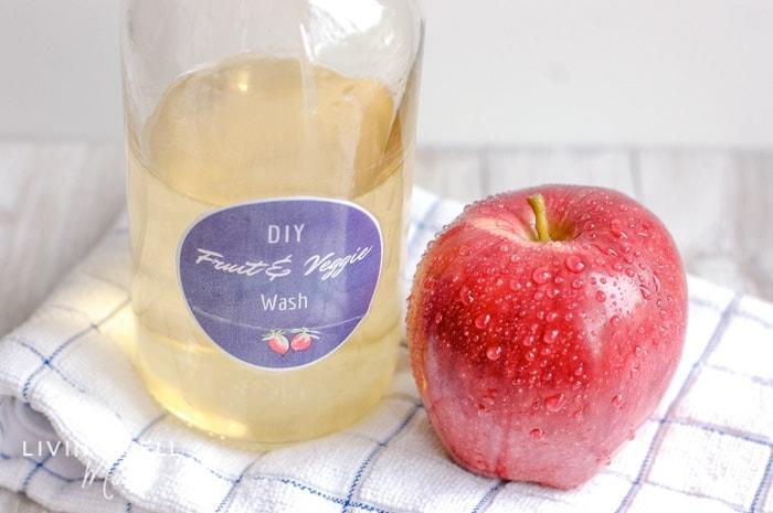 DIY produce wash next to a freshly washed apple.