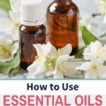 jasmine essential oil, flowers, and bottle
