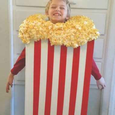 a kid wearing a popcorn Halloween costume