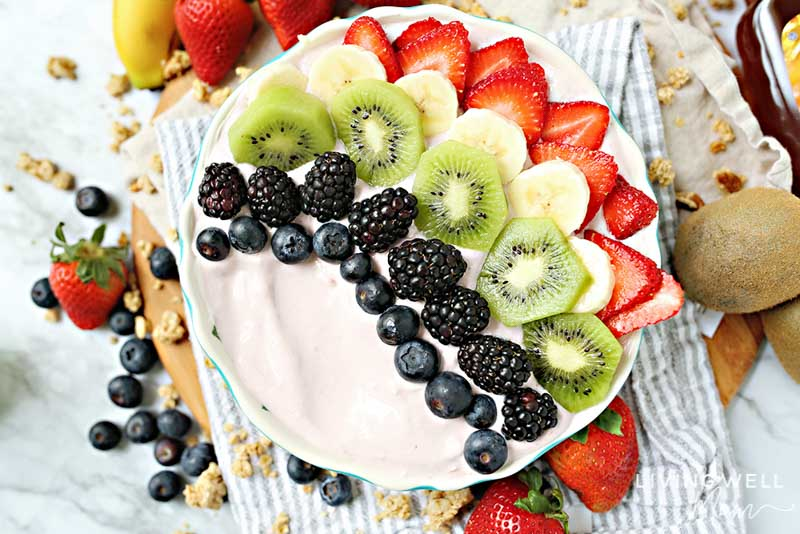 fruit and yogurt bowl with berries, kiwi, bananas, strawberries