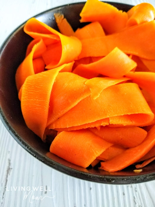 peeled carrot noodles in a bowl