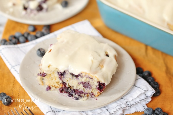 blueberry dump cake with cream cheese icing on a plate