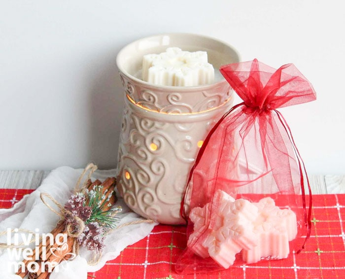 DIY scented wax melts for Christmas in a warmer with red gift bag