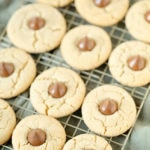 gluten-free peanut butter blossom cookies on a wire rack