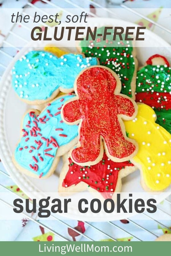 frosted gluten-free sugar cookies on a plate with Christmas sprinkles
