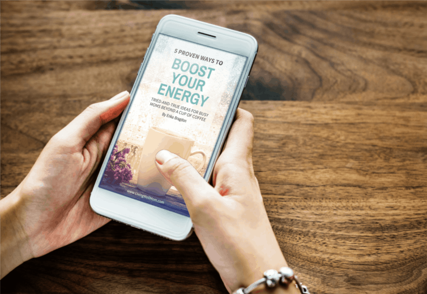 woman holding phone feature boost your energy book