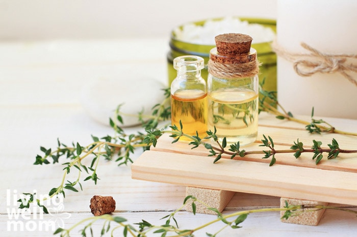 thyme leaves with essential oil bottles