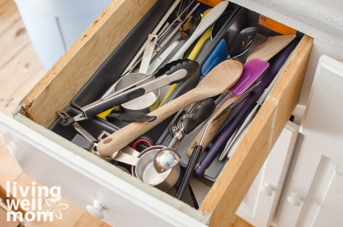 a messy utensil drawer in a kitchen