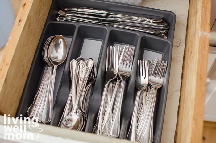 a utensil tray in a drawer, with forks spoons and knives inside