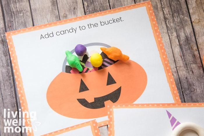 Playdough pieces filling a candy bucket halloween printable mat