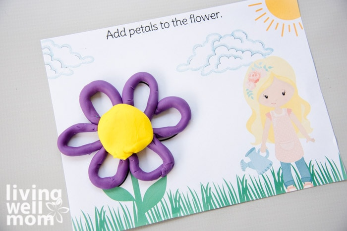 purple play-doh making petals of a flower