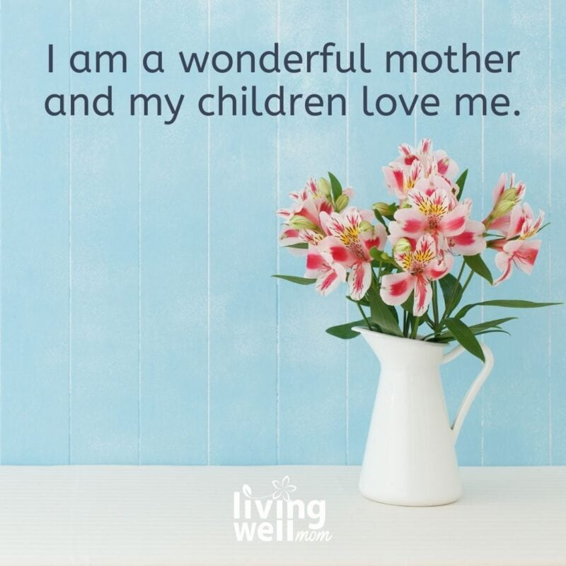 """A positive affirmation card on blue background prompting moms to say, """"I am a wonderful mother and my children love me."""""""