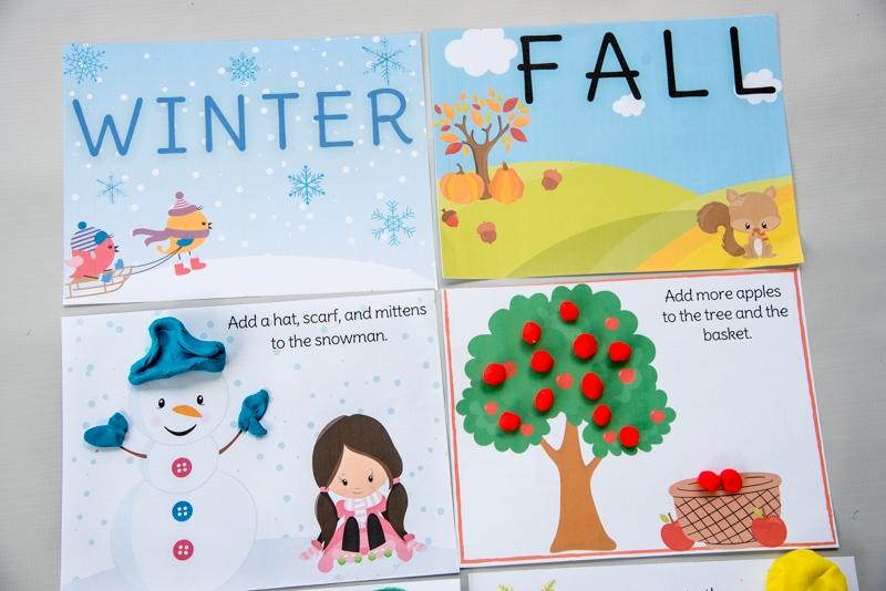 winter and fall seasonal playdough mats on gray background