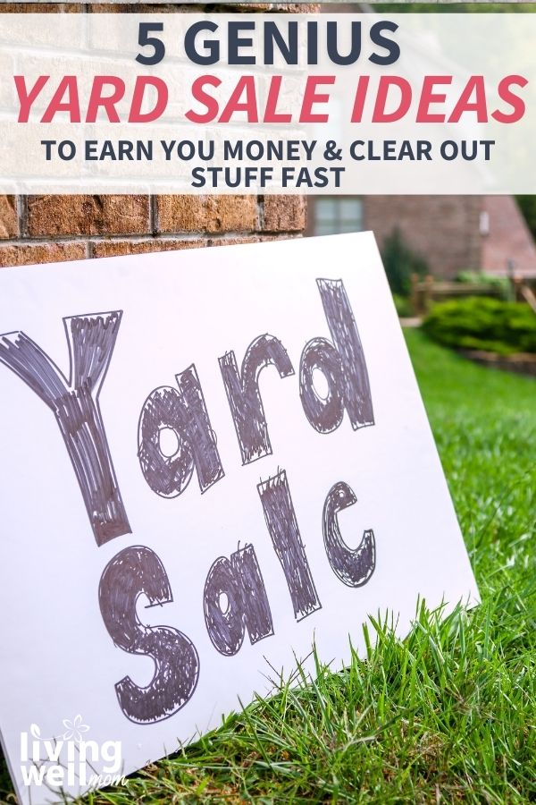 yard sale sign leaning against a house