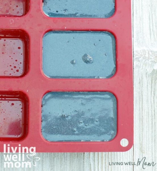 DIY charcoal soap bars drying in a soap mold
