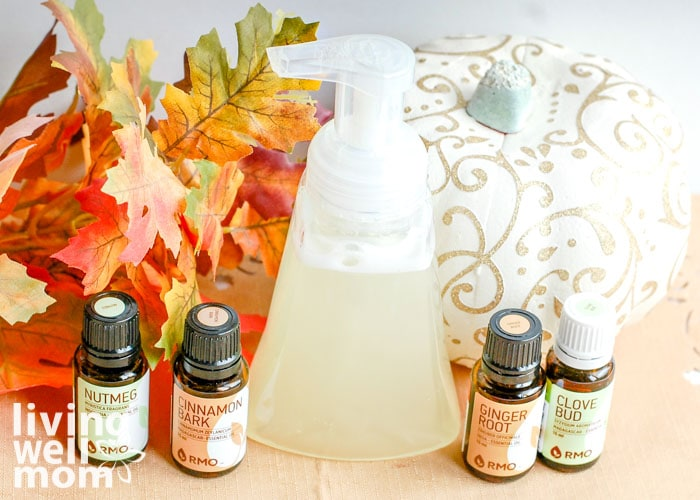 DIY foaming hand soap next to essential oils