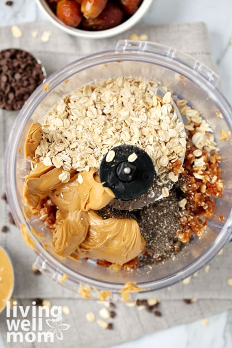 Ingredients for energy balls in a food processor.