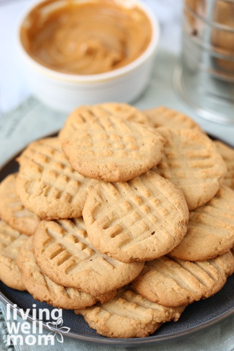Pile of gluten free peanut butter cookies on a plate.