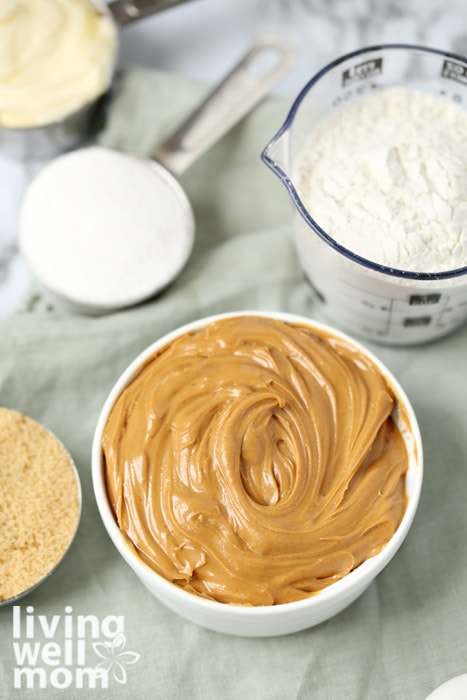 Ingredients for gluten free peanut butter such as sugar, peanut butter, and flour.